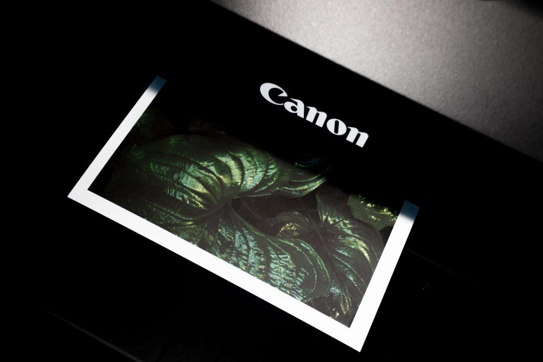 Black Canon printer printing a page