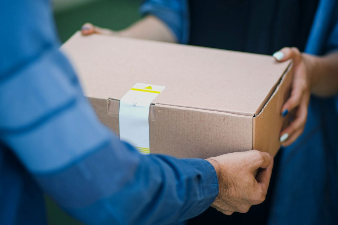 Person delivering brown box package